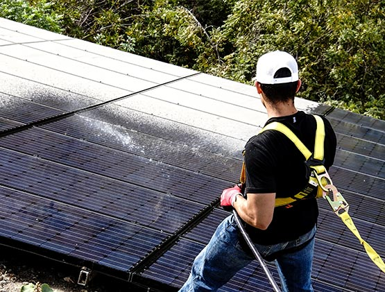 Another Man Cleaning Solar Panels