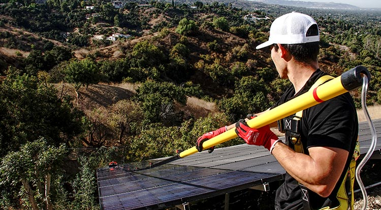 Man Cleaning Solar Panels