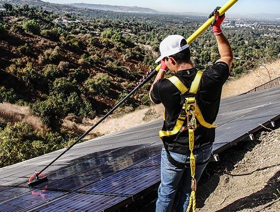 Man Cleaning Solar Panels