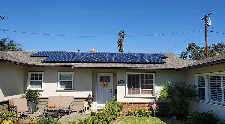 House with Solar Panel Installed on the Roof